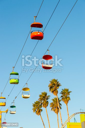 This picture shows a view of a skyride taken from the beach below early in the morning when no people are around.