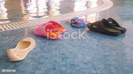 Beach slippers before the pool.