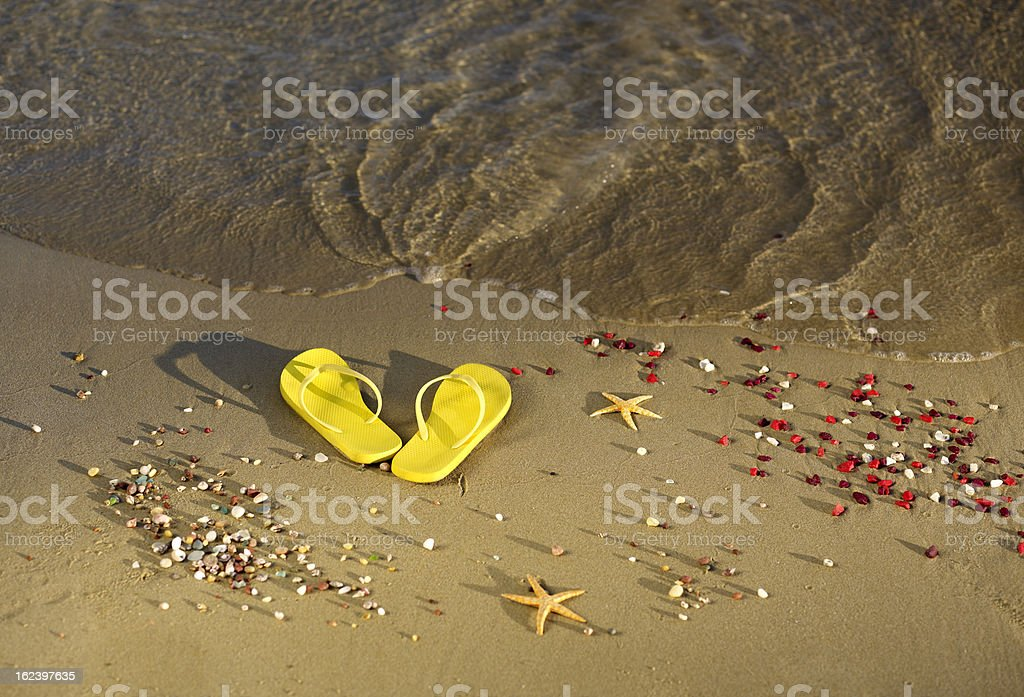 Beach slippers on a sandy royalty-free stock photo