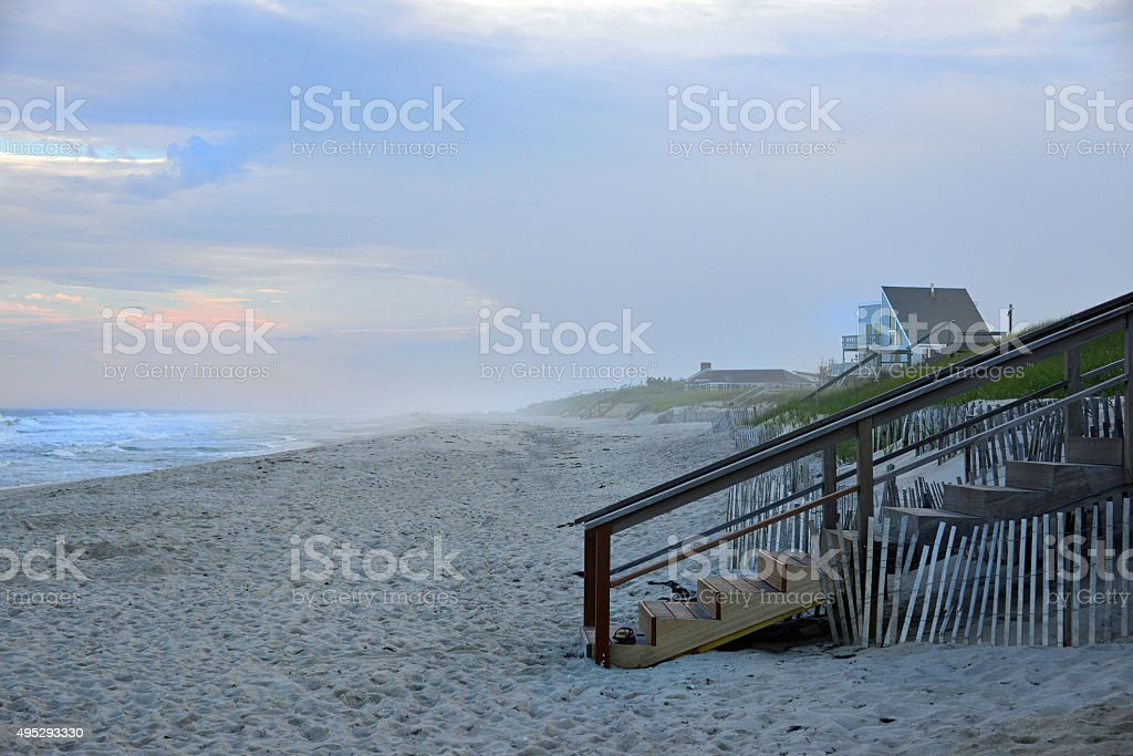 Beach stairs and homes stock photo