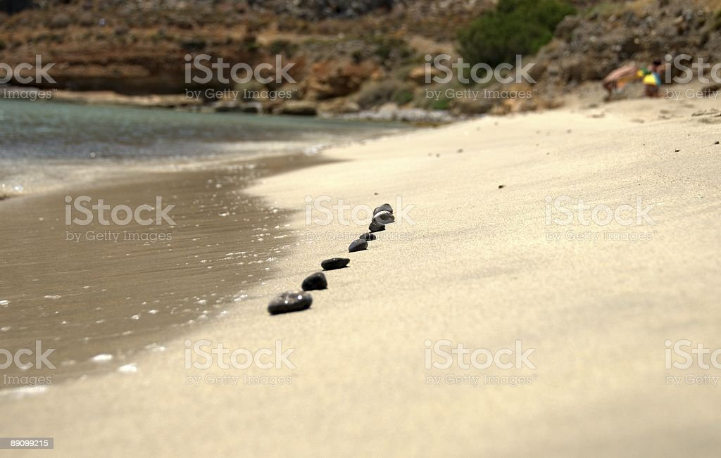 Beach stones (pebbles) in a row stock photo