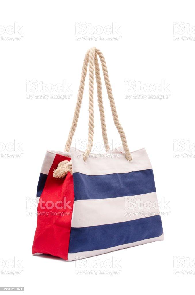 孤立在白色的海灘條紋的手提包 免版稅 stock photo