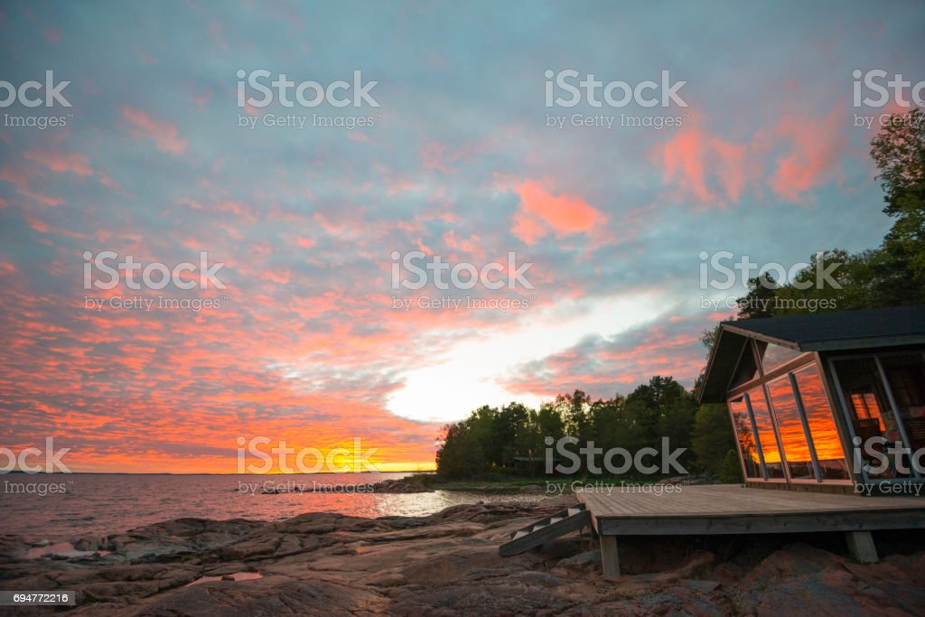 Beach summer house terrace sunset stock photo