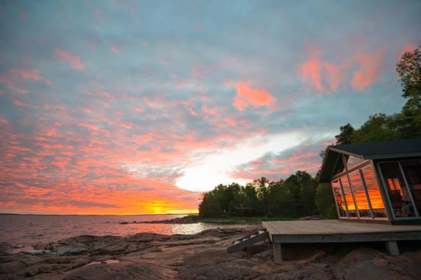 Beach summer house terrace sunset stock photo
