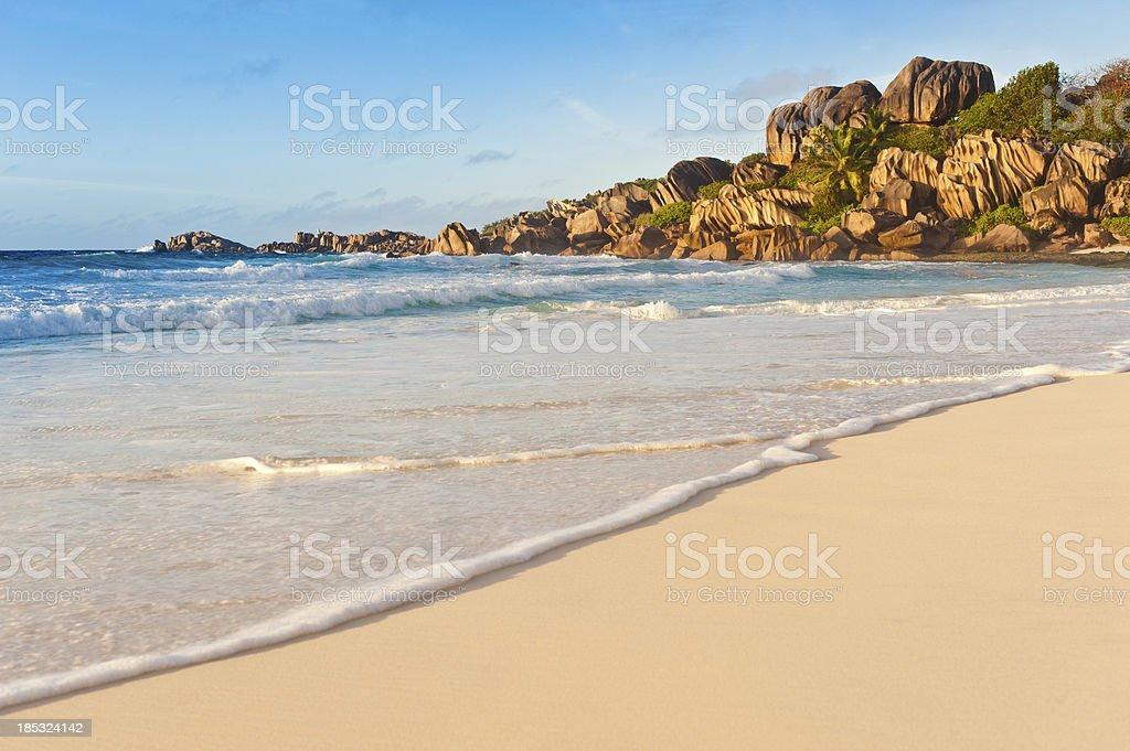 Beach sunrise golden surf shore tropical island paradise royalty-free stock photo
