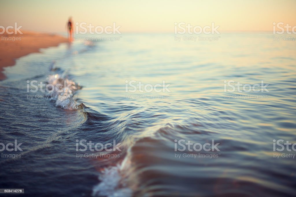 beach sunset abstract background shoreline stock photo