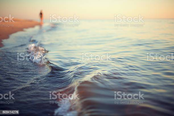 Photo of beach sunset abstract background shoreline