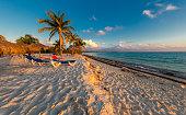 Cayo Largo, Cuba, Latin America, Summer, beach chair, Tropical Climate,Beach Umbrellas made of palm leafs on exotic beach