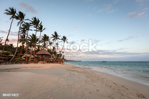 Beautiful warm twilight light close to sunset at beautiful natural beach. Vacation Paradise Fiji. Korotogo Coast, South Coast, Western Division, Fiji, Oceania.