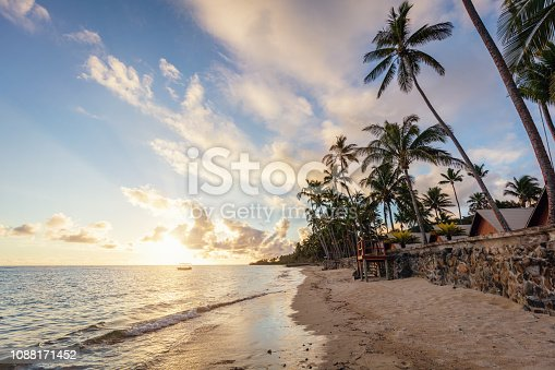Beautiful sunset over the pacific ocean at scenic natural beach Viti Levu, Fiji. Korotogo Coast, South Coast, Western Division, Fiji, Oceania