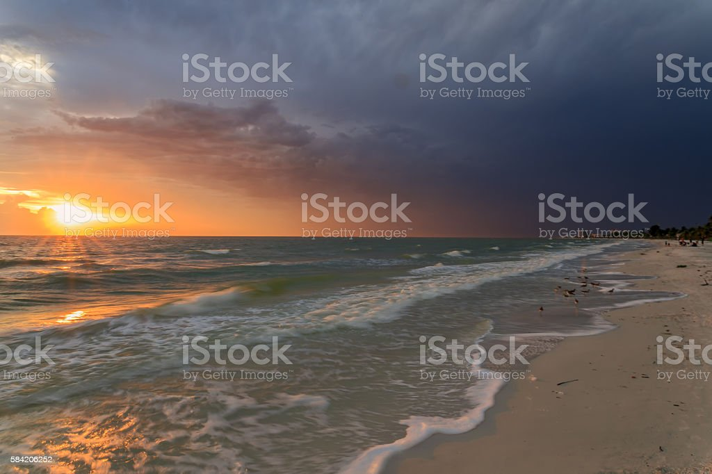 Beach sunset yellow sun stock photo