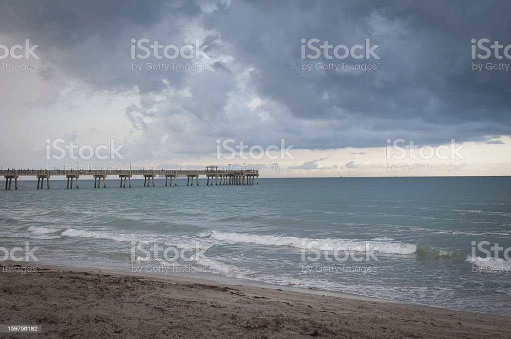 Beach, surf and pier stock photo