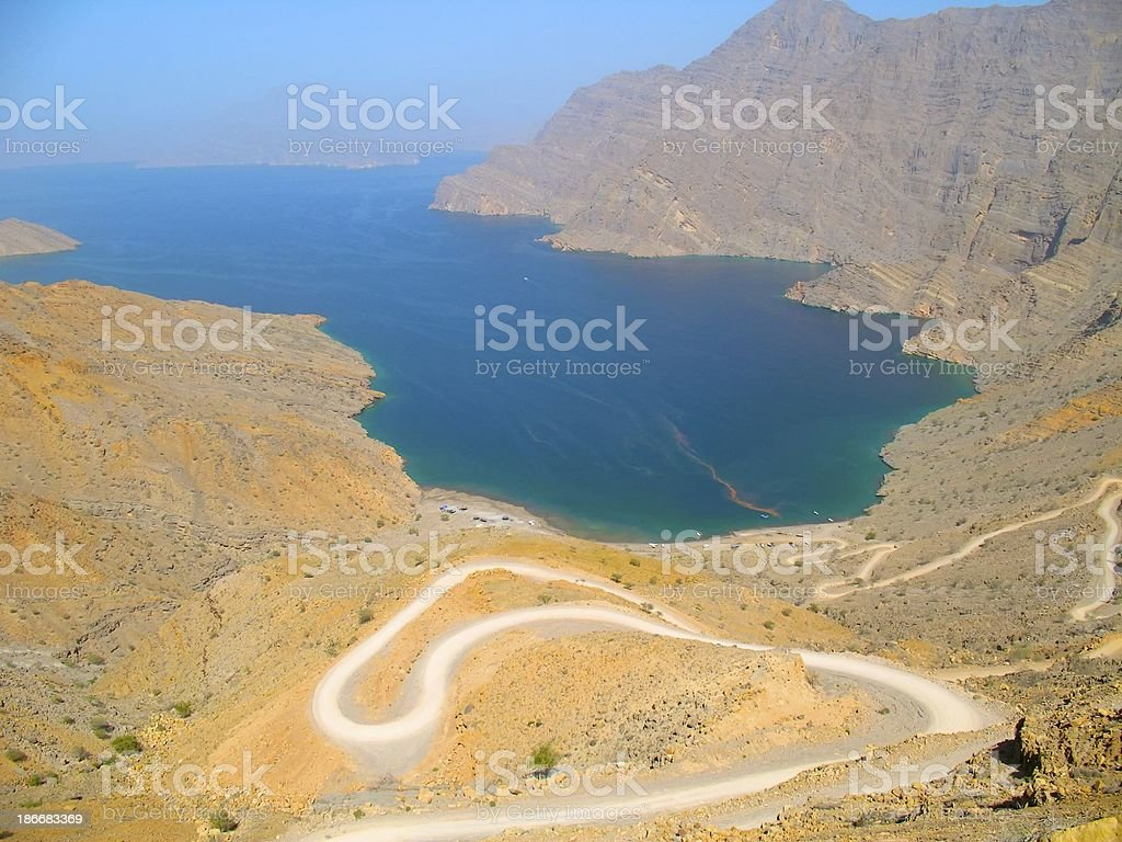 Beach Surrounded by Hill & Mountain,Oman royalty-free stock photo