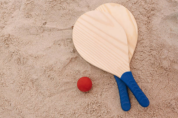 beach tennis, beach paddle ball, matkot. beach rackets and ball - racket stock pictures, royalty-free photos & images