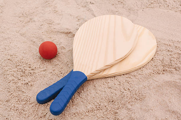 Beach tennis, beach paddle ball, matkot. Beach rackets and ball stock photo