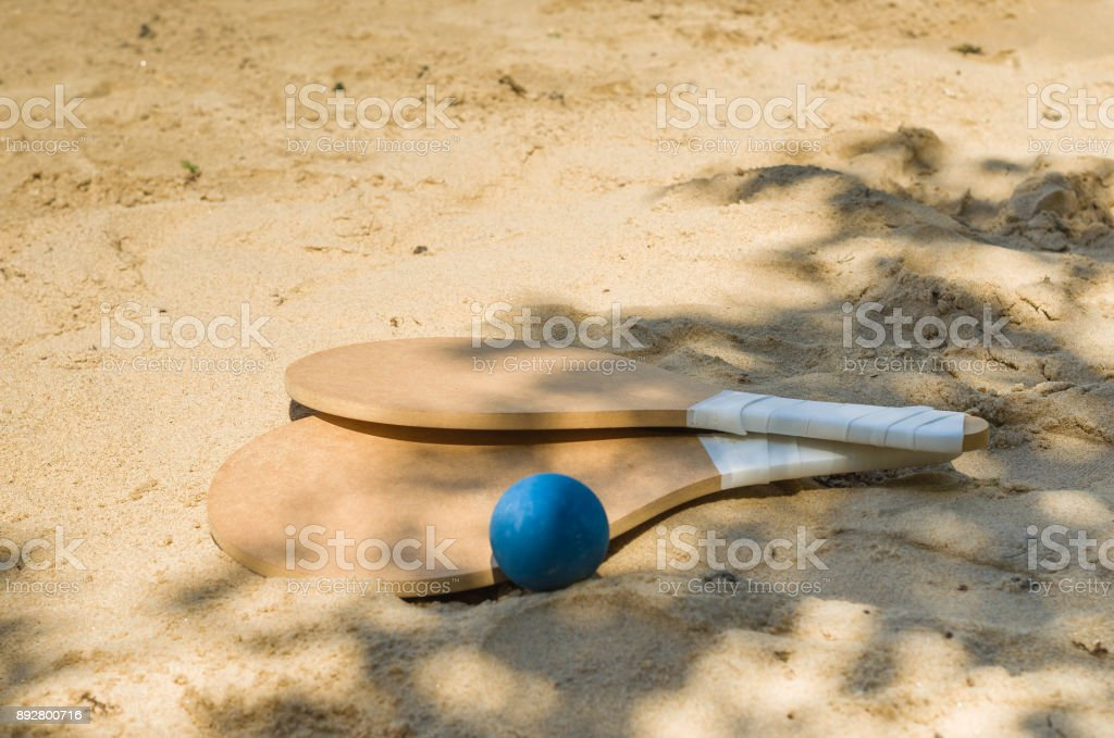 Beach tennis rackets stock photo