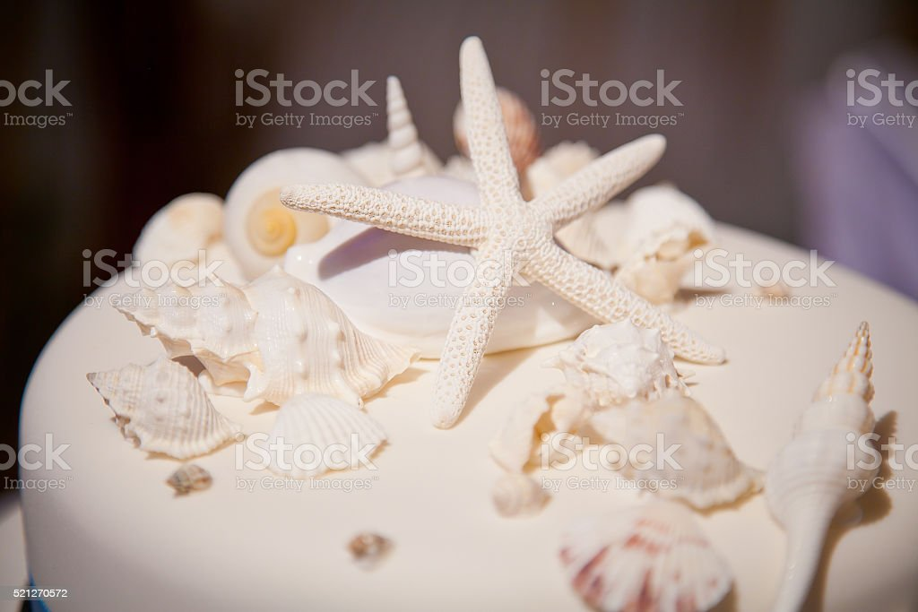 Beach Theme Wedding Cake with Starfish and Shells stock photo
