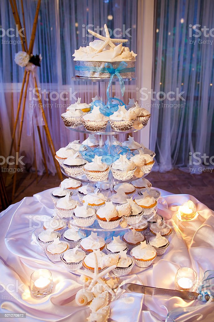Beach Theme Wedding Cup Cakes with Starfish and Shells stock photo