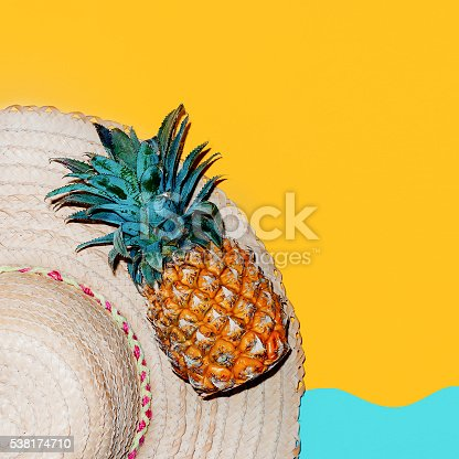 istock Beach time. Tropical style accessories. Hat and fresh pineapple. 538174710