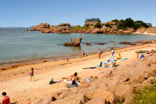 Beach - Tourists - Trégastel (Breton: Tregastell) is a commune in the Côtes-d'Armor department of the region of Brittany in northwestern France. stock photo