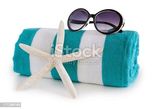 Beach towel and sun glasses
