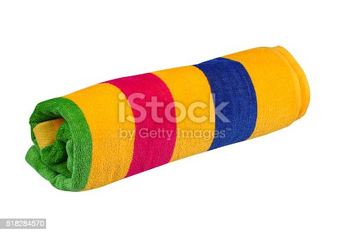 Rolled up beach towel isolated on white