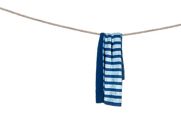 Beach towel on rope stock photo