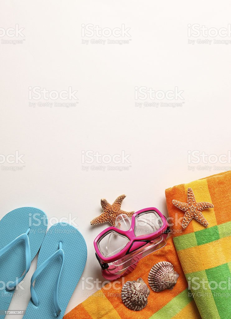 Beach towel seashells flip flop and dive mask royalty-free stock photo