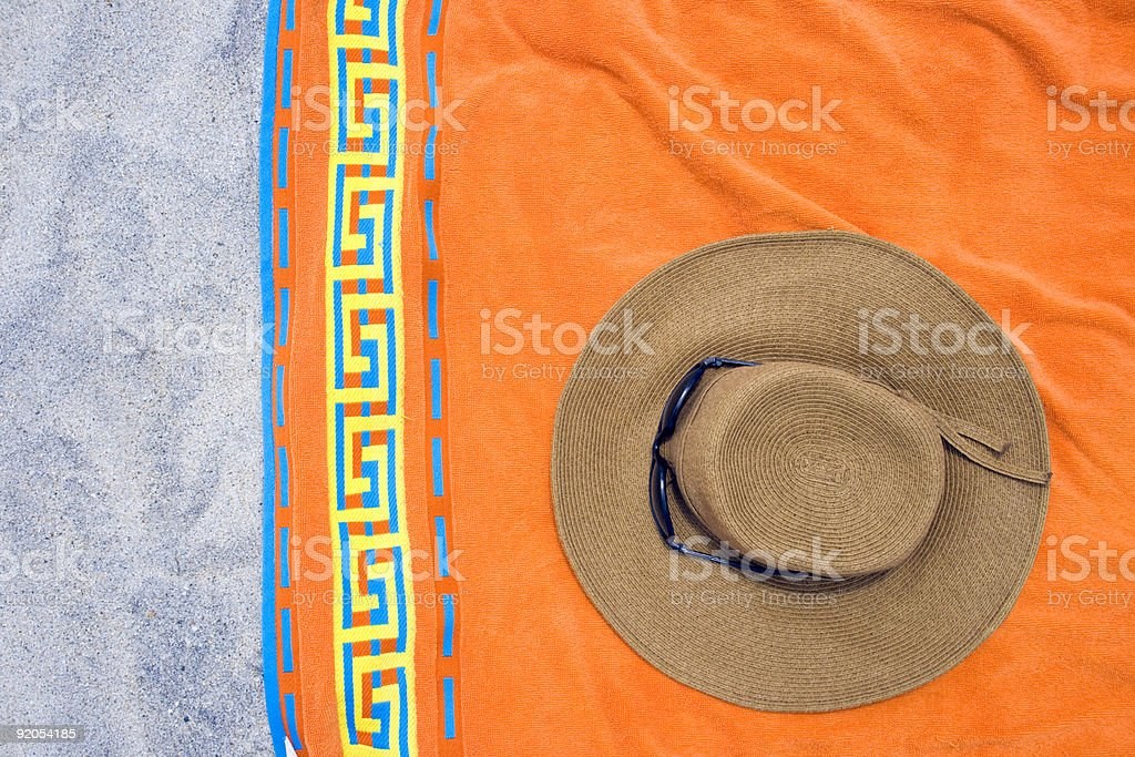 Beach towell with strawhat royalty-free stock photo