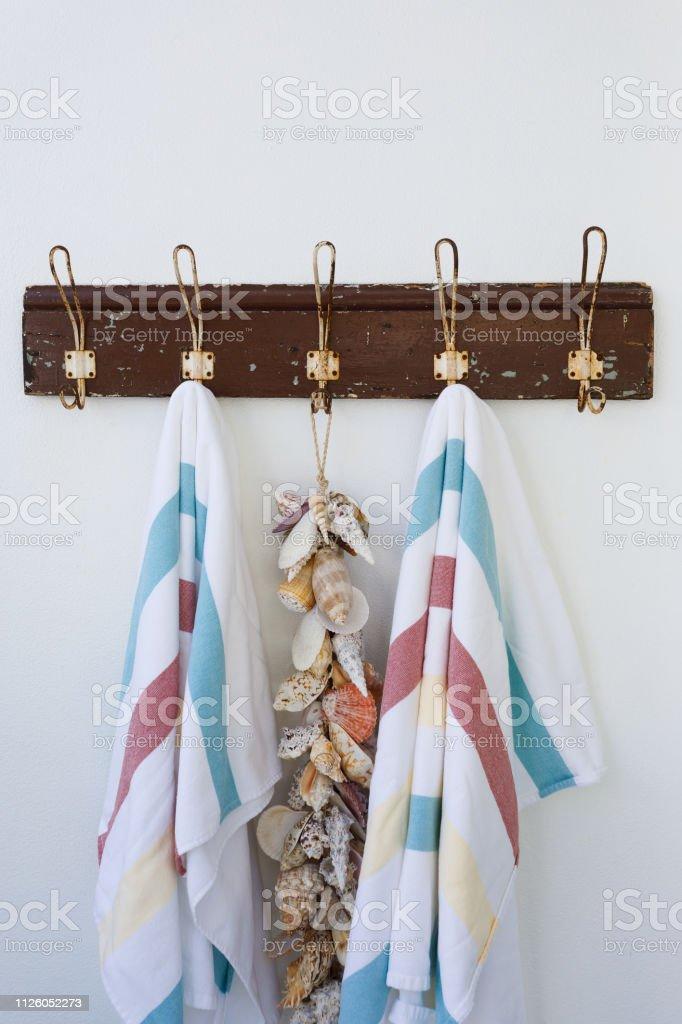 Beach Towels Hanging On Towel Rail In Beach Shack
