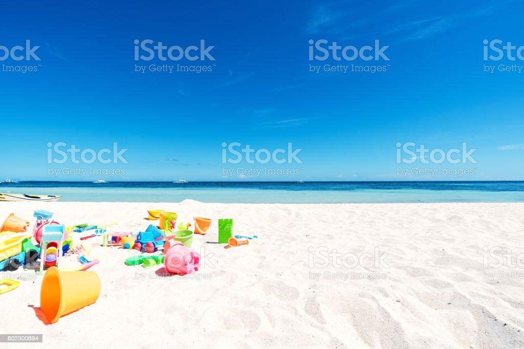 Beach toys on white sand stock photo