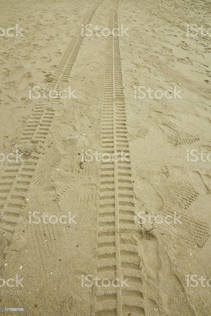 Beach tyre tracks stock photo