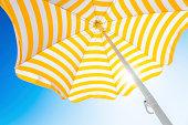 istock Beach umbrella against blue morning sky 171582500