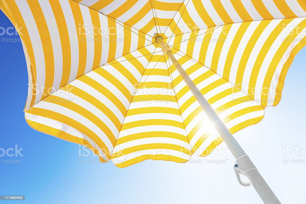 Beach umbrella against blue morning sky stock photo