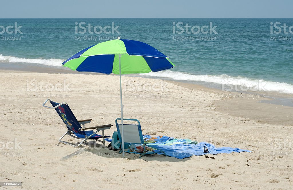 Beach Umbrella and Chair by Ocean royalty-free stock photo