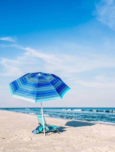 Beach Umbrella and Chair stock photo