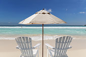 Chairs and umbrella in vacations tropical beach. Summer vacation and tropical beach concept.