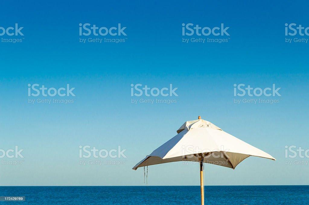 Beach umbrella at the sea royalty-free stock photo
