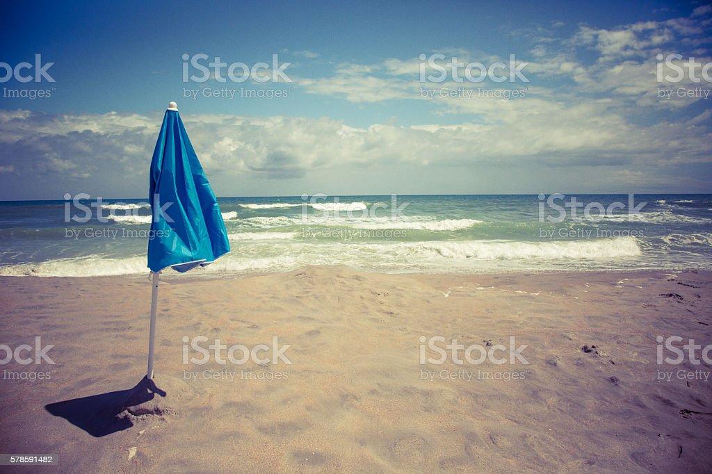 Beach umbrella in sand stock photo