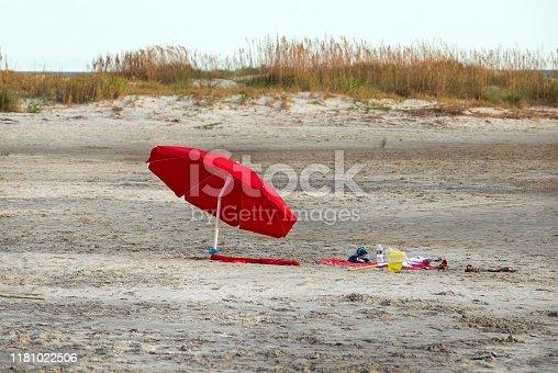 A red beach umbrella at St Simon's Island, GA, near sunset.