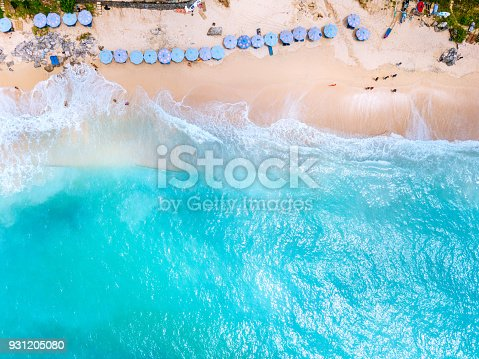 931756010 istock photo Beach umbrellas and blue ocean. Beach scene from above 931205080