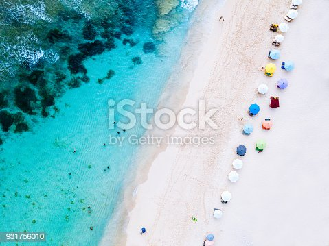 931756010 istock photo Beach umbrellas and blue ocean. Beach scene from above 931756010