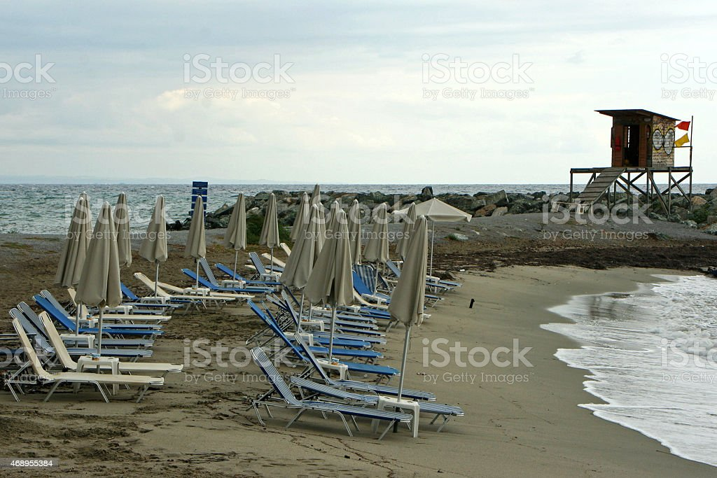 Beach umbrellas and lifeguard hut stock photo