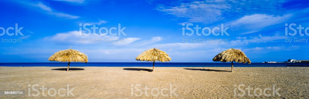 Beach umbrellas made with palm leaves stock photo