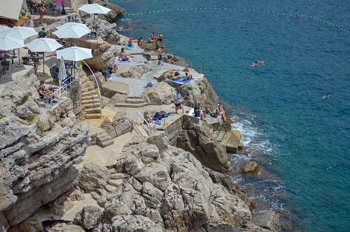 Beach under walls of old town Dubrovnik