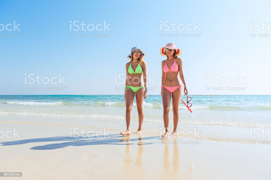 Beach vacation snorkel girl snorkeling with mask and fins. Bikini women relaxing on summer tropical getaway doing snorkeling activity with snorkel tuba and flippers sun tanning. Suntan skin body care. stock photo