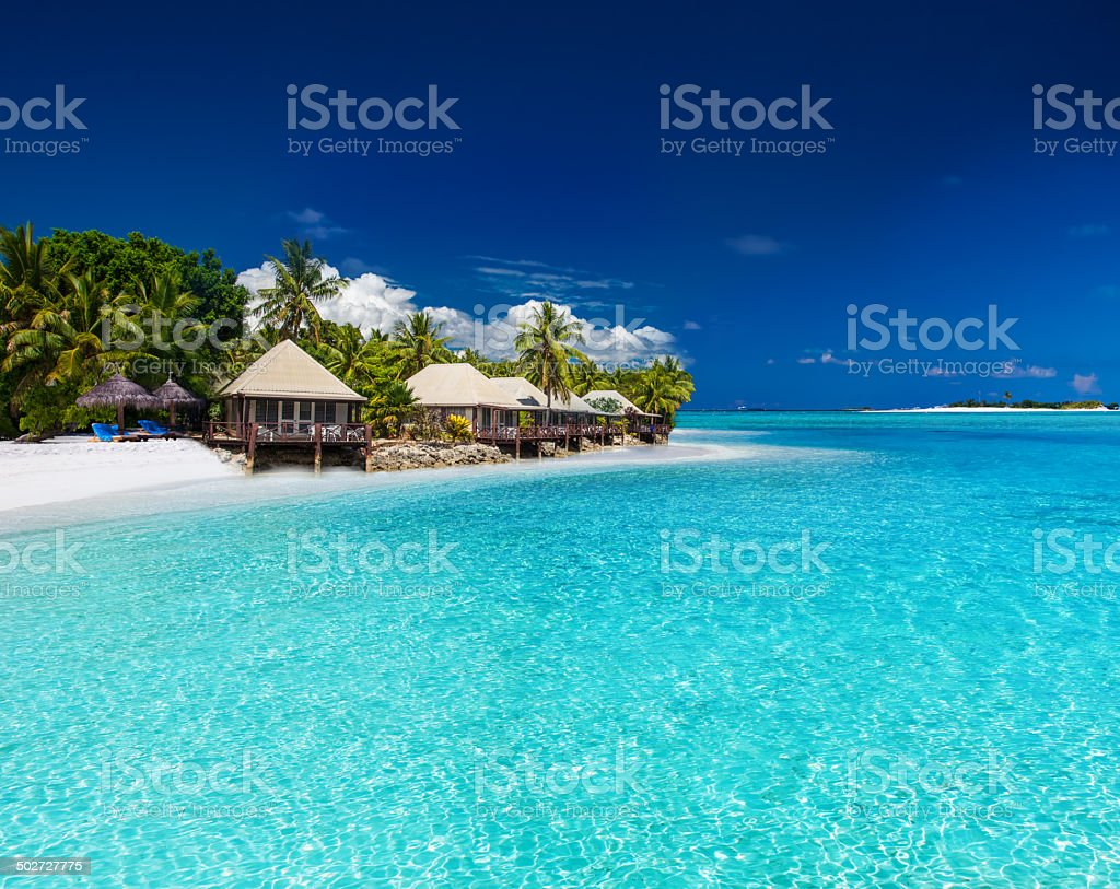 Beach Villas on small tropical island stock photo
