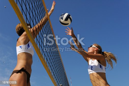 istock Beach volley action in mid-air 157612025