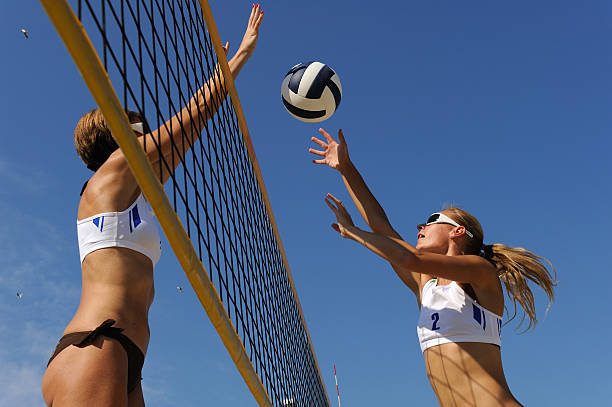 Beach volley action in mid-air stock photo