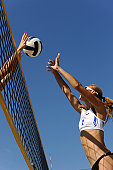 Side view of two attractive female volleybal players in the action